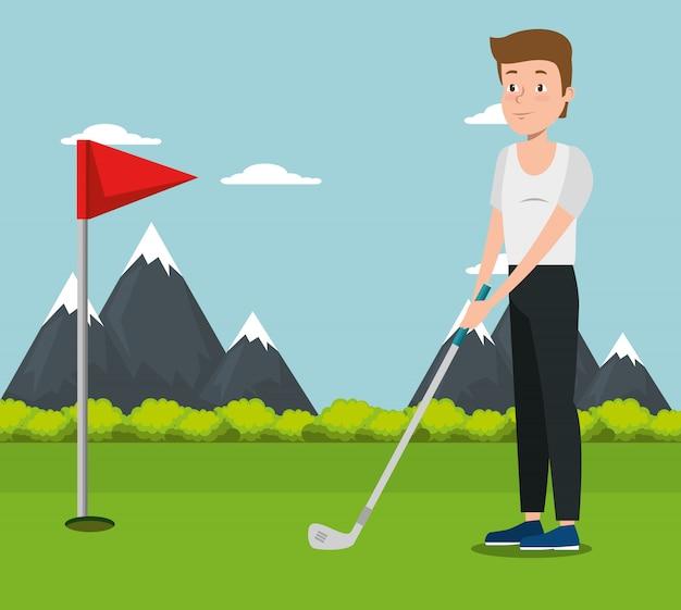若い男がゴルフの練習