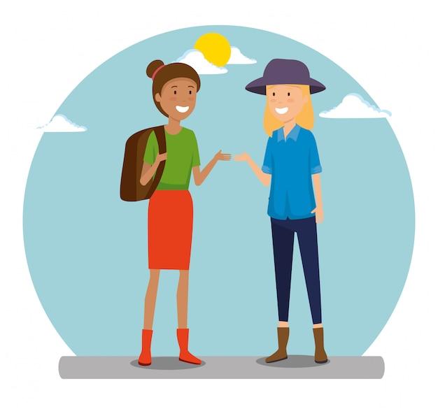バックパックと旅行への帽子を持つ女性