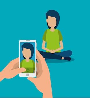 手の中の少年とスマートフォンの技術が写真を撮る