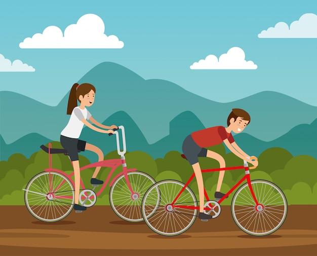 男と女の友人が自転車に乗って
