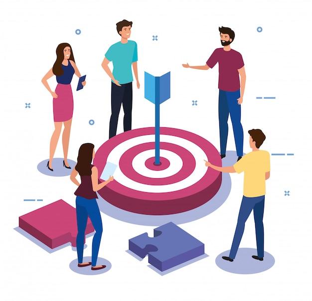 ターゲットとパズルのピースを持つチームワークの人々