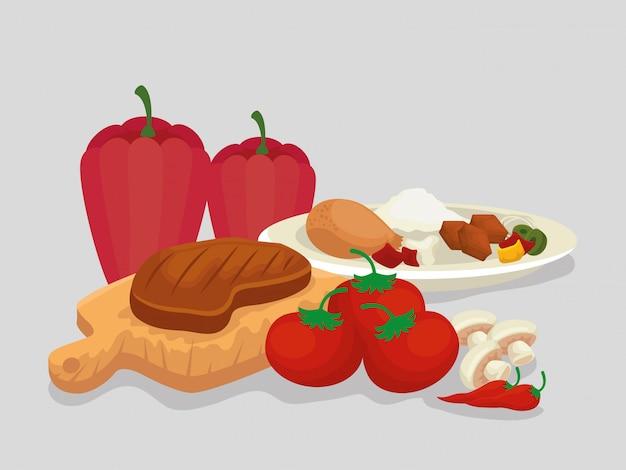 Мясо с колбасками, еда с рисом и овощами