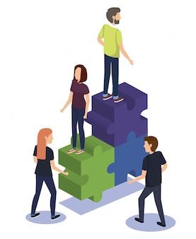 パズルのピースと人々のチームワークのグループ