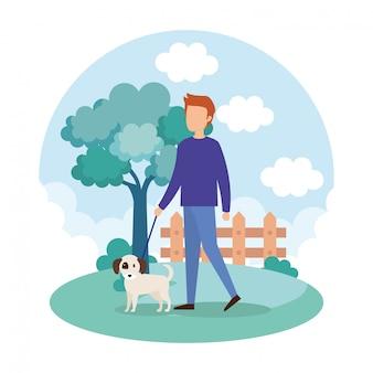 公園で犬と若い男