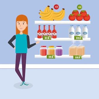 スーパーマーケットの食料品を持つ消費者