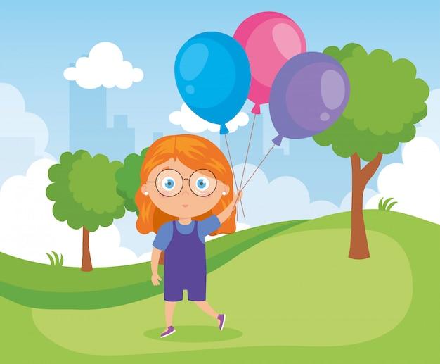 Девушка в парке с воздушными шарами гелия