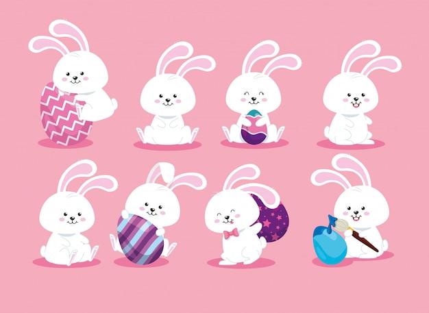 Группа милых кроликов и пасхальных яиц