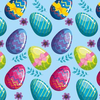 花で飾られた卵イースターのシームレスパターン