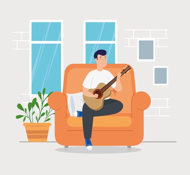 キャンペーンは、ギターを弾く居間の男性と一緒に家にいます