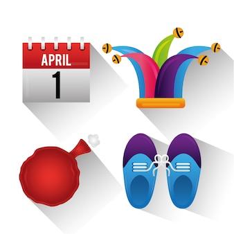 愚か者の日のお祝いの帽子のクッションの靴とカレンダー