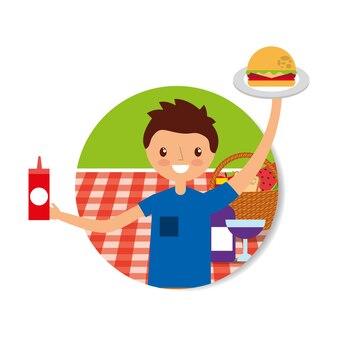 ピクニックでハンバーガーとケチャップを持っている幸せな若い男