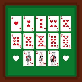 緑のテーブルに心臓スーツのトランプのセット