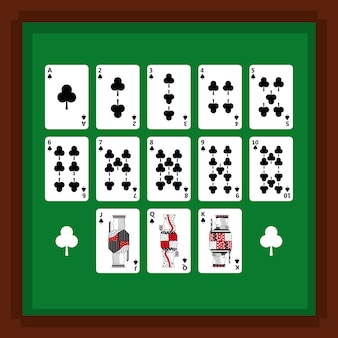 緑のテーブルにクラブのスーツのカードをプレイするポーカーのセット