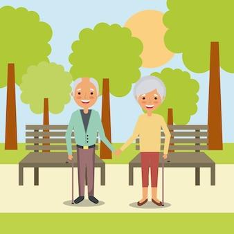 年配の男と女性が公園に手を置くカップル