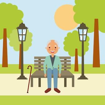 Старик дедушка сидит в скамейке ожидания