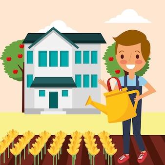 かわいい庭師の男の子が家の庭に花を吹く