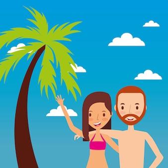熱帯の風景に幸せな手を振るカップルの観光客