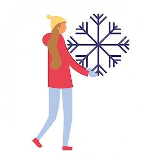 冬の服と雪片を持つ女性