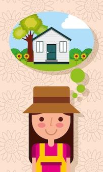 庭の木の花が付いている家で考える幸せな若い女