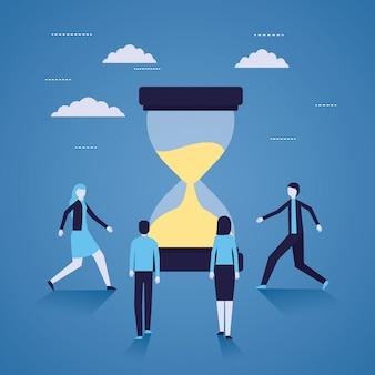 ビジネスマンおよび女性の砂時計の時間