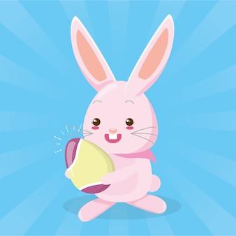 Милый кролик с пасхальным яйцом