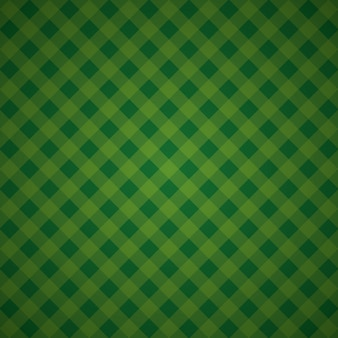緑の幾何学的な背景の市松模様の織物モザイク