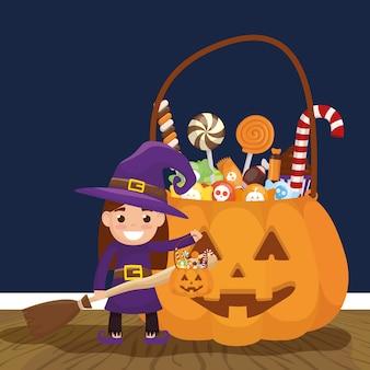 Маленькая девочка с ведьмой маскировки и конфеты тыквы