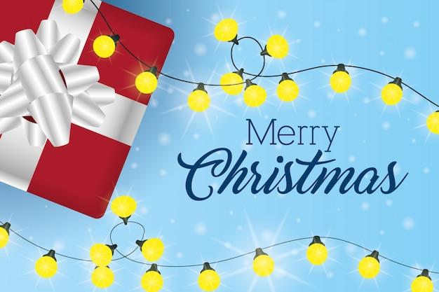 Веселая рождественская открытка с подарком и огнями