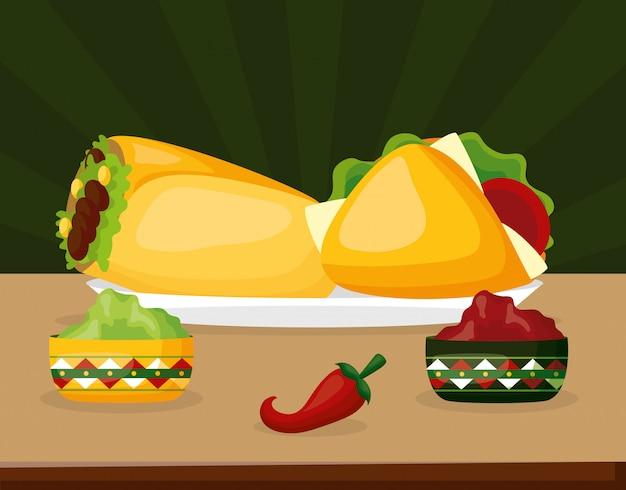 唐辛子、アボカド、タコスをグリーンの上に乗せたメキシコ料理