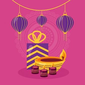 ギフトとキャンドルのお祝いアイコンとハッピーディワリ祭カード