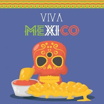 Празднование вива мексики с маской смерти и едой