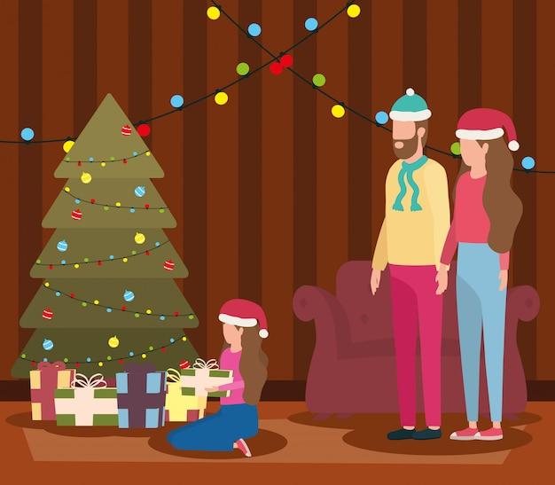 Родители и дочь празднуют рождество в гостиной с деревом