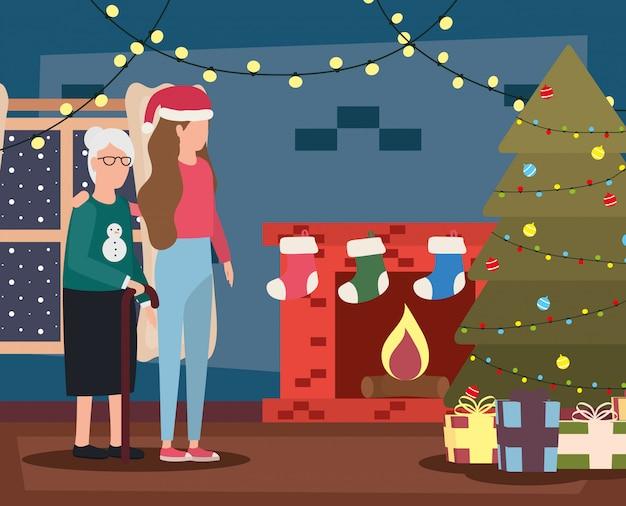 祖母と娘のクリスマスデコレーション付きのリビングルームで