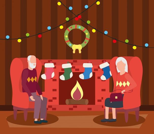 クリスマスの装飾とリビングルームで祖父母のカップル