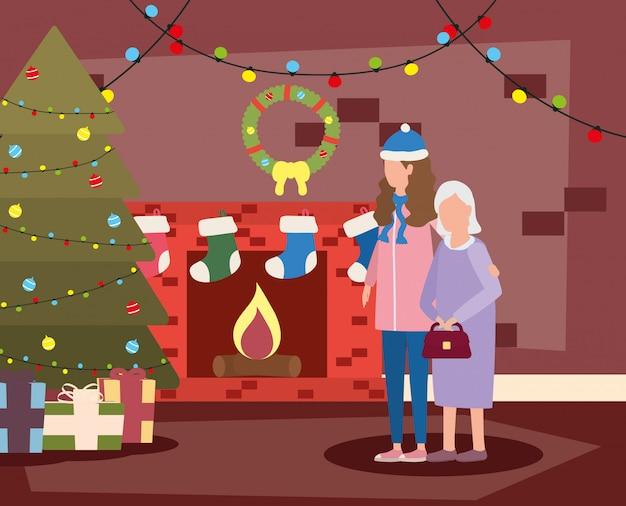 部屋のクリスマスの娘とかわいい祖母が飾られて