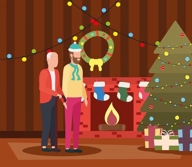 クリスマスの部屋で若い息子とかわいい祖父の装飾