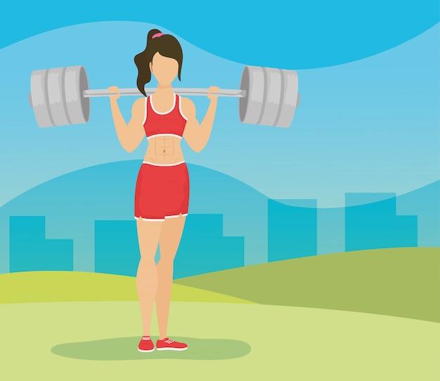 キャンプで若い女性アスリート重量挙げ