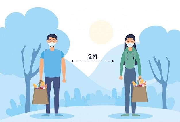 食料品の買い物袋と社会的距離とフェイスマスクを使用してカップル