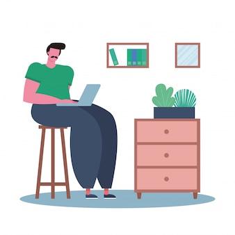 ラップトップを使用して、家で働く若い男