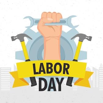 手とレンチで幸せな労働者の日のお祝い