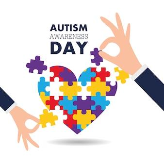 自閉症意識の日のサポート手パズルピースの心