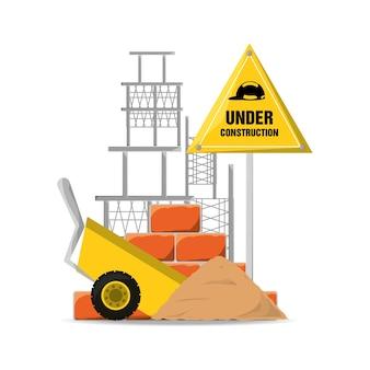 Строящееся предупреждение и тележка с цементом