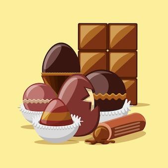 チョコレートの卵と黄色の背景の上にチョコレートバーとトリュフ