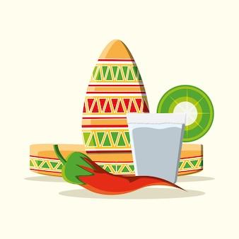 メキシコの帽子と白い背景の上にテキーラのカップとチリ