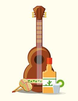 白い背景のメキシカンギターとテキーラのボトル