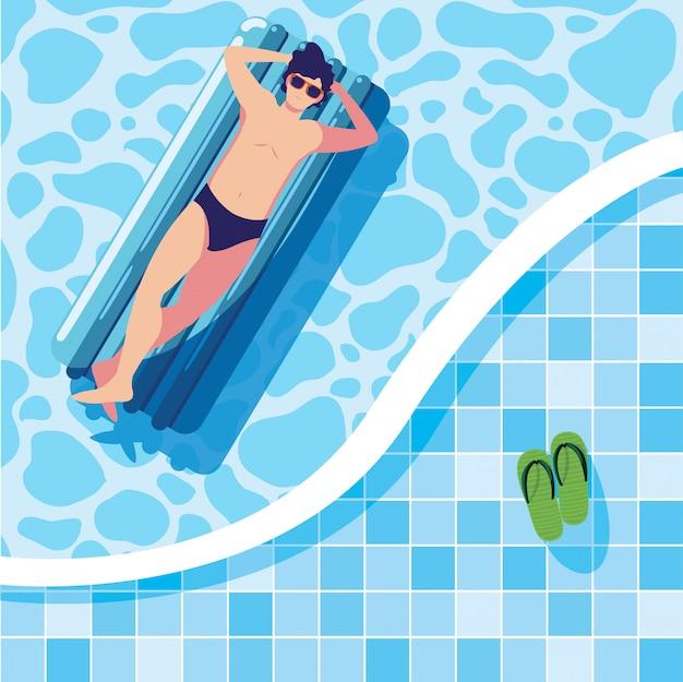 男はプールでフロートで日焼け