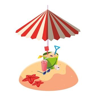 夏の砂浜の傘と砂のバケツのおもちゃ