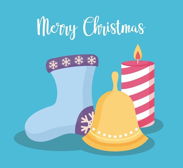 ベルとクリスマスのキャンドルで装飾的な靴下