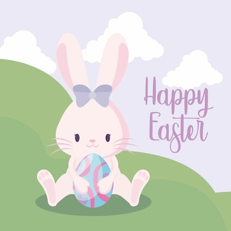 イースター、おめでとう。風景の中のイースターエッグとかわいいウサギの女性