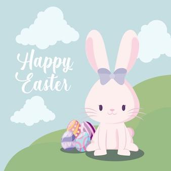 ハッピーイースターのグリーティングカード。風景の中のイースターの卵を持つかわいいウサギ女性